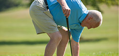Man playing golf after joint replacement orthopedic surgery